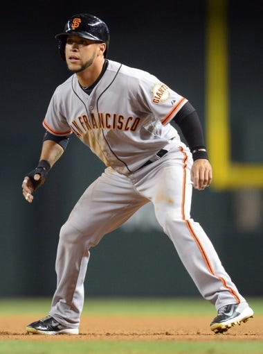 Jun 21, 2014; Phoenix, AZ, USA; San Francisco Giants left fielder Gregor Blanco (7) leads off of first base in the fourth inning against the Arizona Diamondbacks at Chase Field. Mandatory Credit: Joe Camporeale-USA TODAY Sports