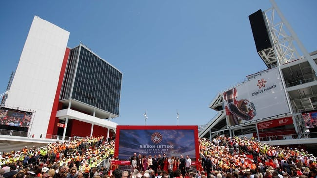 Jul 17, 2014; Santa Clara, CA, USA; San Francisco CEO Jed York and Santa Clara mayor Jamie Matthews are surrounded by dignitaries and family whiel flanked on stage by construction workers during the ribbon cutting ceremony at Levi's Stadium. Mandatory Credit: Kelley L Cox-USA TODAY Sports