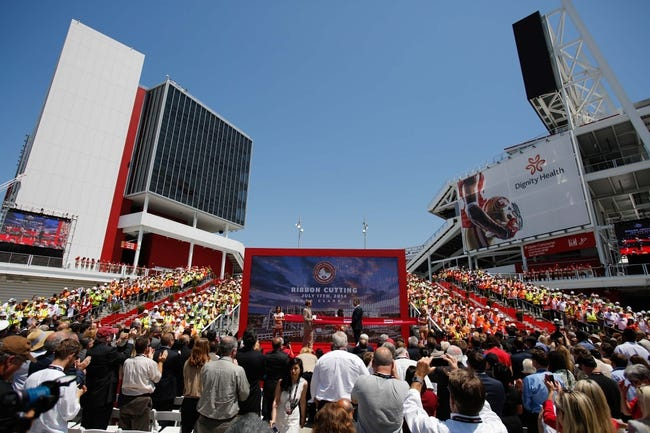 Jul 17, 2014; Santa Clara, CA, USA; Construction workers flank the stage during the ribbon cutting ceremony at Levi's Stadium. Mandatory Credit: Kelley L Cox-USA TODAY Sports