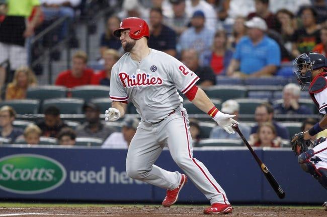Jul 18, 2014; Atlanta, GA, USA; Philadelphia Phillies catcher Cameron Rupp (29) hits an RBI single against the Atlanta Braves in the second inning at Turner Field. Mandatory Credit: Brett Davis-USA TODAY Sports