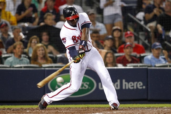 Jul 18, 2014; Atlanta, GA, USA; Atlanta Braves left fielder Justin Upton (8) hits a double against the Philadelphia Phillies in the fifth inning at Turner Field. Mandatory Credit: Brett Davis-USA TODAY Sports