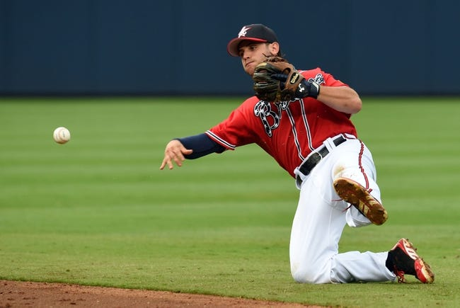 Jul 19, 2014; Atlanta, GA, USA; Atlanta Braves second baseman Tommy La Stella (7) throws out a Philadelphia Phillies batter after making a diving stop during the second inning at Turner Field. Mandatory Credit: Dale Zanine-USA TODAY Sports