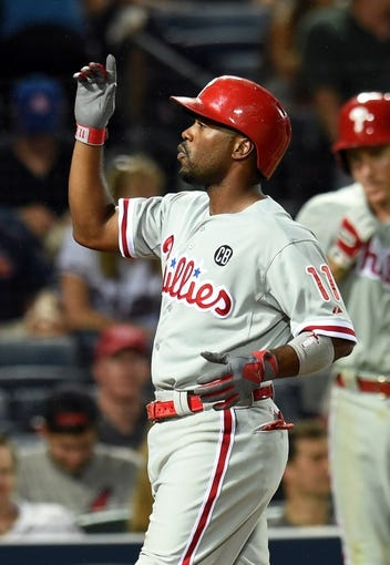 Jul 19, 2014; Atlanta, GA, USA; Philadelphia Phillies shortstop Jimmy Rollins (11) reacts after hitting a home run against the Atlanta Braves during the seventh inning at Turner Field. Mandatory Credit: Dale Zanine-USA TODAY Sports