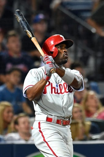 Jul 19, 2014; Atlanta, GA, USA; Philadelphia Phillies shortstop Jimmy Rollins (11) watches his home run against the Atlanta Braves during the seventh inning at Turner Field. The Phillies defeated the Braves 2-1. Mandatory Credit: Dale Zanine-USA TODAY Sports