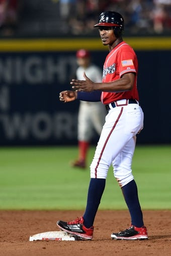 Jul 19, 2014; Atlanta, GA, USA; Atlanta Braves center fielder B.J. Upton (2) reacts after being caught stealing second base against the Philadelphia Phillies during the eighth inning at Turner Field. The Phillies defeated the Braves 2-1. Mandatory Credit: Dale Zanine-USA TODAY Sports