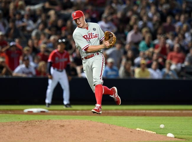 Jul 19, 2014; Atlanta, GA, USA; Philadelphia Phillies third baseman Cody Asche (25) can't bare hand a ground ball against the Atlanta Braves during the eighth inning at Turner Field. The Phillies defeated the Braves 2-1. Mandatory Credit: Dale Zanine-USA TODAY Sports