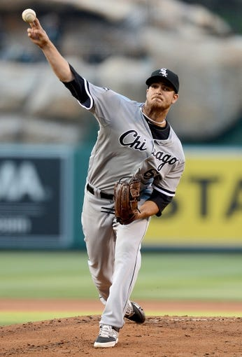 Jun 6, 2014; Anaheim, CA, USA; Chicago White Sox starting pitcher Andre Rienzo (64) in the first inning of the game against the Los Angeles Angels at Angel Stadium of Anaheim. Mandatory Credit: Jayne Kamin-Oncea-USA TODAY Sports