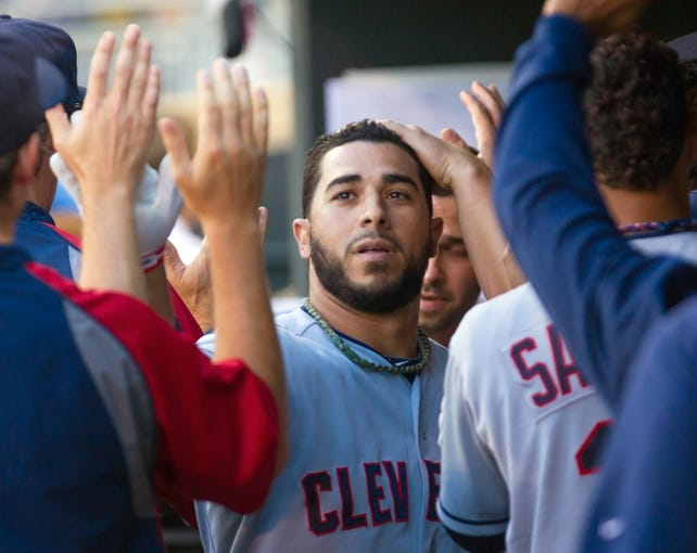 Jul 22, 2014; Minneapolis, MN, USA; Cleveland Indians shortstop Mike Aviles (4) gets congratulated after he scores in the second inning against the Minnesota Twins at Target Field. Mandatory Credit: Brad Rempel-USA TODAY Sports