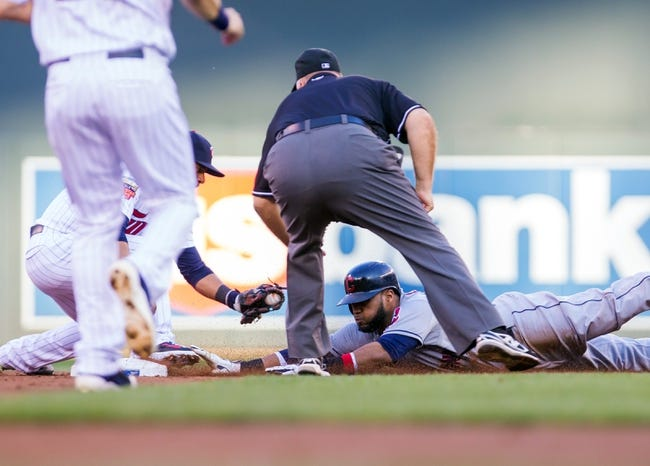 Jul 22, 2014; Minneapolis, MN, USA; (Editors note: Caption correction) Cleveland Indians first baseman Carlos Santana (41) slides safely into second in the second inning against the Minnesota Twins shortstop Eduardo Escobar (5) at Target Field. Mandatory Credit: Brad Rempel-USA TODAY Sports