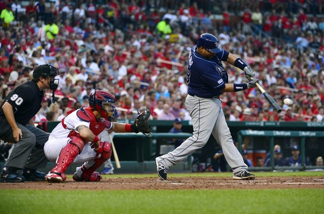 Jul 22, 2014; St. Louis, MO, USA; Tampa Bay Rays catcher Jose Molina (28) hits a single off of St. Louis Cardinals starting pitcher Adam Wainwright (not pictured) during the second inning at Busch Stadium. Mandatory Credit: Jeff Curry-USA TODAY Sports
