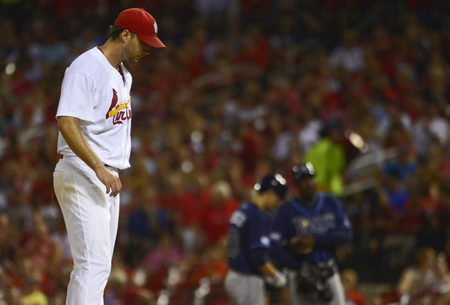 Jul 22, 2014; St. Louis, MO, USA; St. Louis Cardinals starting pitcher Adam Wainwright (50) waits on the mound after walking Tampa Bay Rays starting pitcher Jake Odorizzi (not pictured) during the fifth inning at Busch Stadium. Mandatory Credit: Jeff Curry-USA TODAY Sports