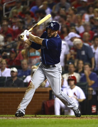 Jul 22, 2014; St. Louis, MO, USA; Tampa Bay Rays left fielder Matt Joyce (20) hits a one run double off of St. Louis Cardinals starting pitcher Adam Wainwright (not pictured) during the fifth inning at Busch Stadium. Mandatory Credit: Jeff Curry-USA TODAY Sports
