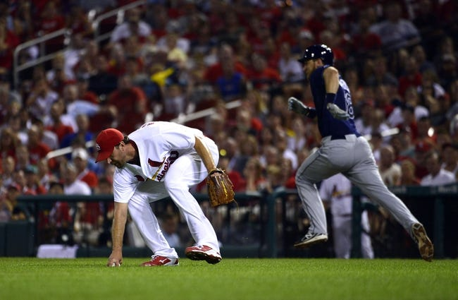 Jul 22, 2014; St. Louis, MO, USA; St. Louis Cardinals starting pitcher Adam Wainwright (50) makes an error on a ball hit by Tampa Bay Rays second baseman Ben Zobrist (18) during the fifth inning at Busch Stadium. Mandatory Credit: Jeff Curry-USA TODAY Sports