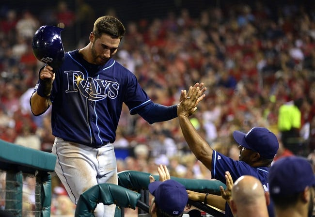 Jul 22, 2014; St. Louis, MO, USA; Tampa Bay Rays right fielder Kevin Kiermaier (39) is congratulated by teammates after scoring during the fifth inning against the St. Louis Cardinals at Busch Stadium. Mandatory Credit: Jeff Curry-USA TODAY Sports
