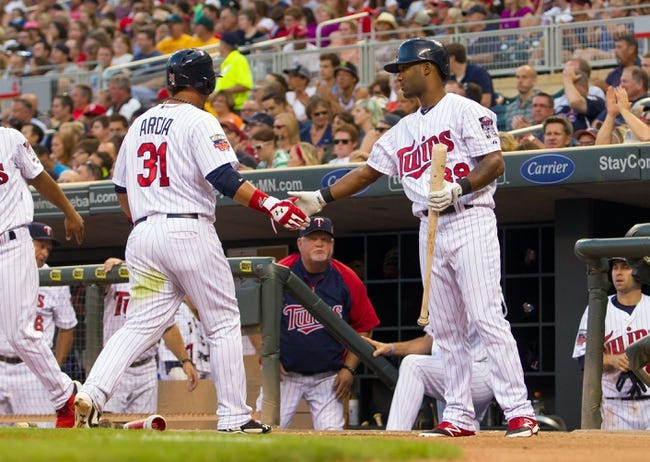 Jul 22, 2014; Minneapolis, MN, USA; Minnesota Twins center fielder Danny Santana (39) congratulates right fielder Oswaldo Arcia (31) after scoring in the fourth inning against the Cleveland Indians at Target Field. The Cleveland Indians win 8-2. Mandatory Credit: Brad Rempel-USA TODAY Sports