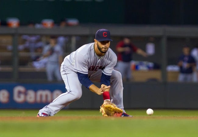 Jul 22, 2014; Minneapolis, MN, USA; Cleveland Indians shortstop Mike Aviles (4) fields a ground ball in the fifth inning against the Minnesota Twins at Target Field. The Cleveland Indians win 8-2. Mandatory Credit: Brad Rempel-USA TODAY Sports