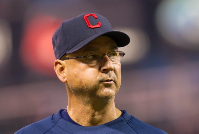 Jul 22, 2014; Minneapolis, MN, USA; Cleveland Indians manager Terry Francona walks back to the dugout in the sixth inning against the Minnesota Twins at Target Field. The Cleveland Indians win 8-2. Mandatory Credit: Brad Rempel-USA TODAY Sports