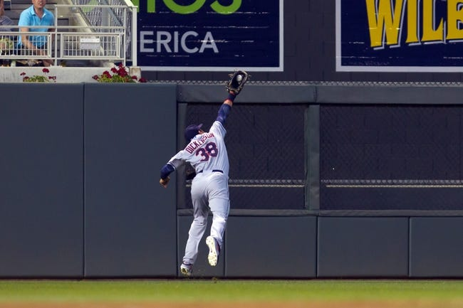 Jul 22, 2014; Minneapolis, MN, USA; Cleveland Indians left fielder Chris Dickerson (38) makes a jumping catch for the out in the fifth inning against the Minnesota Twins at Target Field. The Cleveland Indians win 8-2. Mandatory Credit: Brad Rempel-USA TODAY Sports