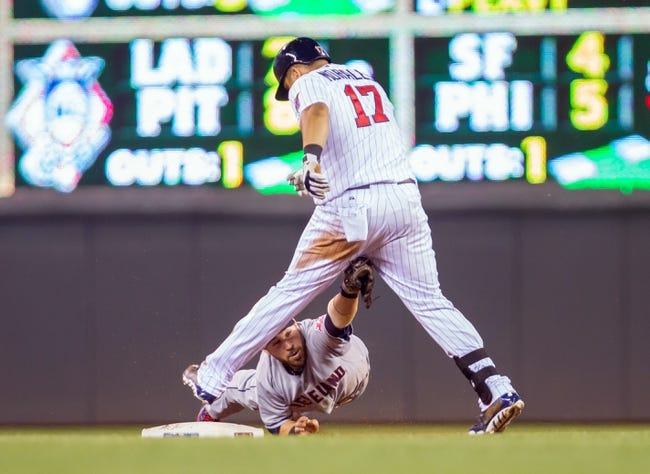 Jul 22, 2014; Minneapolis, MN, USA; Minnesota Twins first baseman Kendrys Morales (17) is tagged out at second by Cleveland Indians second baseman Jason Kipnis (22) in the seventh inning at Target Field. The Cleveland Indians win 8-2. Mandatory Credit: Brad Rempel-USA TODAY Sports