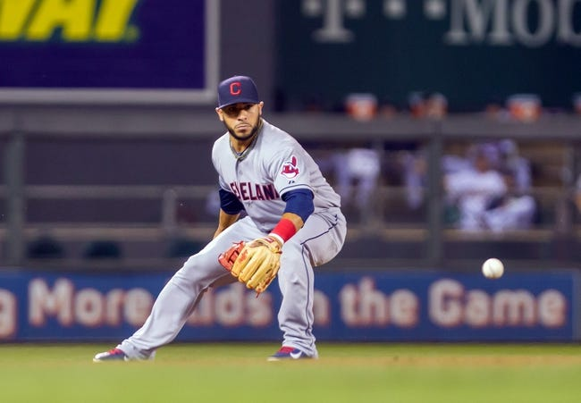 Jul 22, 2014; Minneapolis, MN, USA; Cleveland Indians shortstop Mike Aviles (4) fields a ground ball in the eighth inning against the Minnesota Twins at Target Field. The Cleveland Indians win 8-2. Mandatory Credit: Brad Rempel-USA TODAY Sports