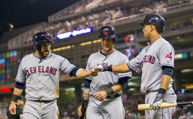 Jul 22, 2014; Minneapolis, MN, USA; Cleveland Indians center fielder Michael Brantley (23) congratulates second baseman Jason Kipnis (left) and catcher Yan Gomes (center) after scoring in the ninth inning against the Minnesota Twins at Target Field. The Cleveland Indians win 8-2. Mandatory Credit: Brad Rempel-USA TODAY Sports