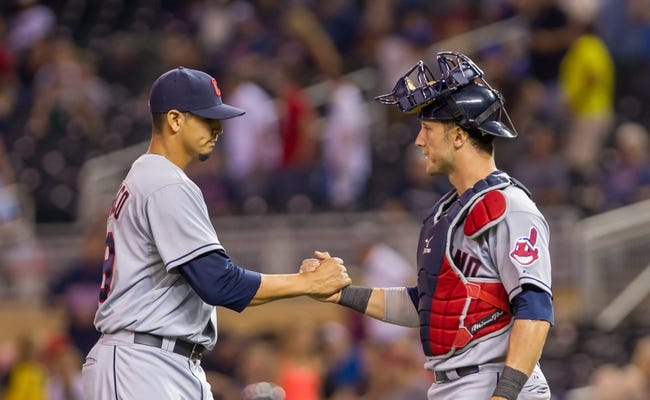 Jul 22, 2014; Minneapolis, MN, USA; Cleveland Indians relief pitcher Carlos Carrasco (59) and catcher Yan Gomes (10) celebrate their win against the Minnesota Twins at Target Field. The Cleveland Indians win 8-2. Mandatory Credit: Brad Rempel-USA TODAY Sports