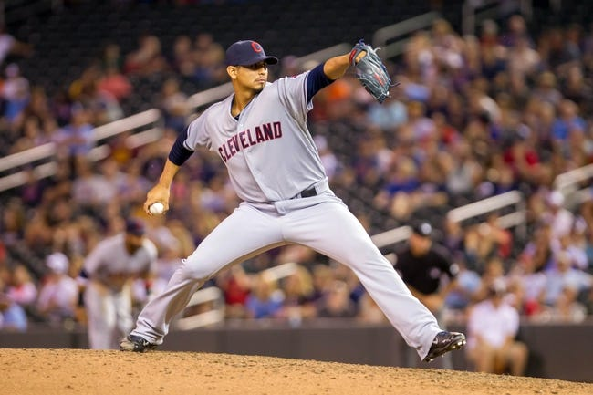 Jul 22, 2014; Minneapolis, MN, USA; Cleveland Indians relief pitcher Carlos Carrasco (59) pitches in the ninth inning against the Minnesota Twins at Target Field. The Cleveland Indians win 8-2. Mandatory Credit: Brad Rempel-USA TODAY Sports