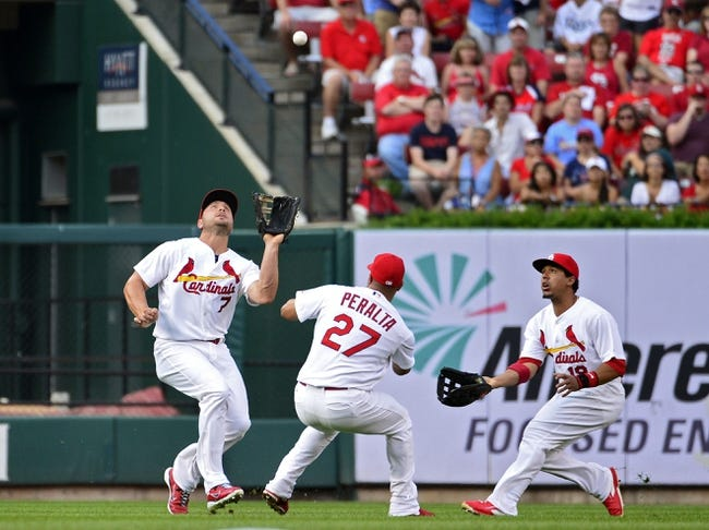 Jul 22, 2014; St. Louis, MO, USA; St. Louis Cardinals left fielder Matt Holliday (7) almost collides with shortstop Jhonny Peralta (27) and center fielder Jon Jay (19) as he catches a fly ball during the first inning against the Tampa Bay Rays at Busch Stadium. The Rays defeated the Cardinals 7-2. Mandatory Credit: Jeff Curry-USA TODAY Sports