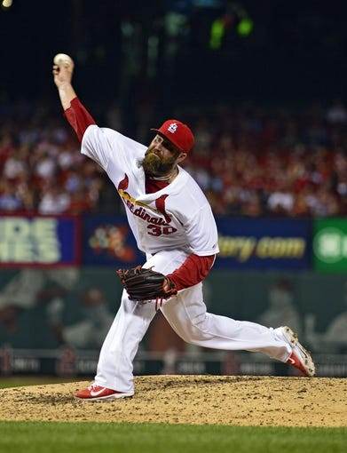 Jul 22, 2014; St. Louis, MO, USA; St. Louis Cardinals relief pitcher Jason Motte (30) throws to a Tampa Bay Rays batter during the eighth inning at Busch Stadium. The Rays defeated the Cardinals 7-2. Mandatory Credit: Jeff Curry-USA TODAY Sports
