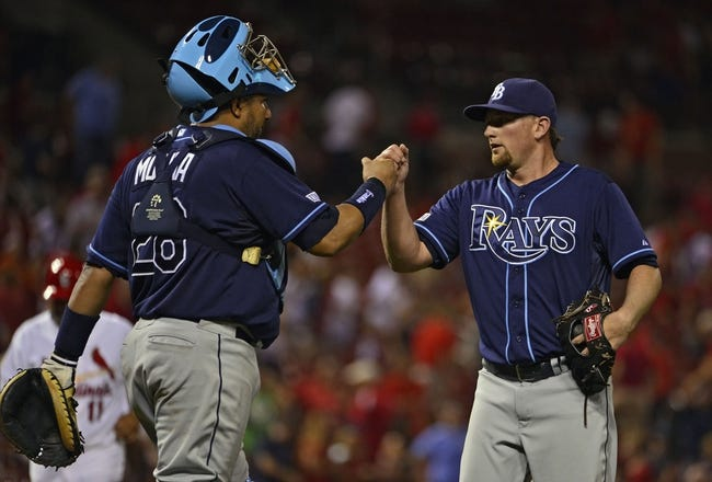 Jul 22, 2014; St. Louis, MO, USA; Tampa Bay Rays relief pitcher Kirby Yates (49) celebrates with catcher Jose Molina (28) after defeating the St. Louis Cardinals at Busch Stadium. The Rays defeated the Cardinals 7-2. Mandatory Credit: Jeff Curry-USA TODAY Sports