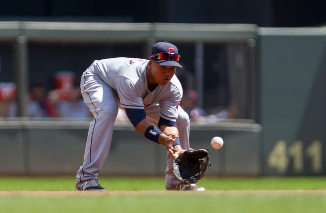 Jul 23, 2014; Minneapolis, MN, USA; Cleveland Indians shortstop Jose Ramirez (11) fields a ground ball in the second inning against the Minnesota Twins at Target Field. Mandatory Credit: Brad Rempel-USA TODAY Sports