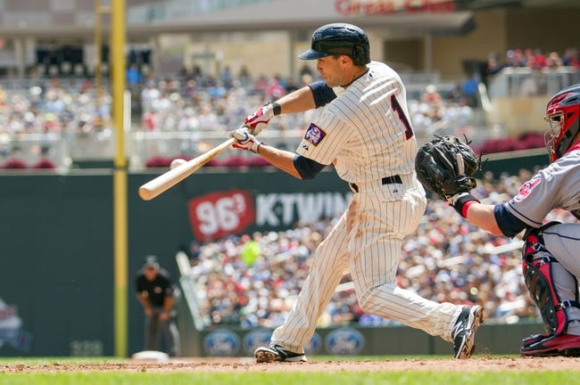 Jul 23, 2014; Minneapolis, MN, USA; Minnesota Twins left fielder Sam Fuld at bat in the third inning against the Cleveland Indians at Target Field. Mandatory Credit: Brad Rempel-USA TODAY Sports