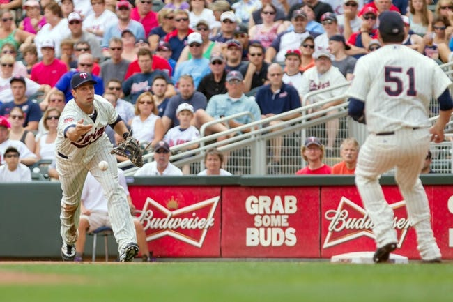 Jul 23, 2014; Minneapolis, MN, USA; Minnesota Twins first baseman Chris Colabello (20) tosses the ball to relief pitcher Anthony Swarzak (51) in the fourth inning against the Cleveland Indians at Target Field. Mandatory Credit: Brad Rempel-USA TODAY Sports