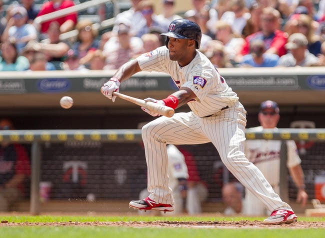 Jul 23, 2014; Minneapolis, MN, USA; Minnesota Twins center fielder Danny Santana (39) bunts in the fifth inning against the Cleveland Indians at Target Field. Mandatory Credit: Brad Rempel-USA TODAY Sports