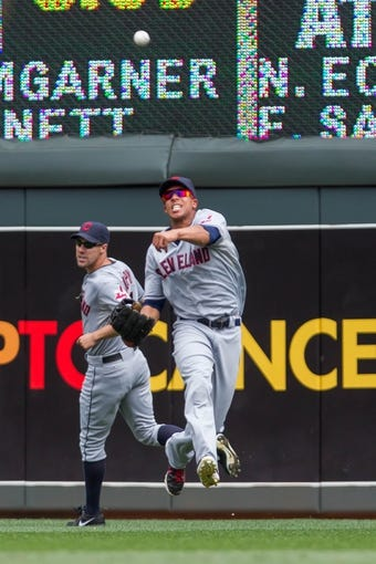 Jul 23, 2014; Minneapolis, MN, USA; Cleveland Indians center fielder Michael Brantley (23) throws to first in the eighth inning against the Minnesota Twins at Target Field. The Minnesota Twins win 3-1. Mandatory Credit: Brad Rempel-USA TODAY Sports