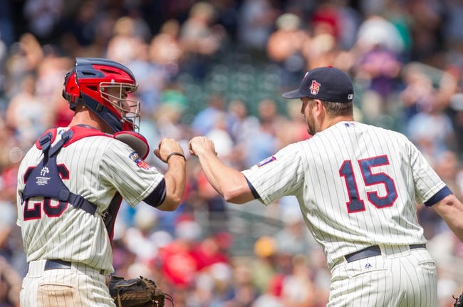 Jul 23, 2014; Minneapolis, MN, USA; Minnesota Twins catcher Eric Fryer (26) and relief pitcher Glen Perkins (15) celebrate the win against the Cleveland Indians at Target Field. The Minnesota Twins win 3-1. Mandatory Credit: Brad Rempel-USA TODAY Sports