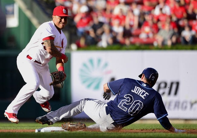 Jul 23, 2014; St. Louis, MO, USA; St. Louis Cardinals second baseman Kolten Wong (16) jumps over Tampa Bay Rays left fielder Matt Joyce (20) as he completes a double play during the first inning at Busch Stadium. Mandatory Credit: Jeff Curry-USA TODAY Sports