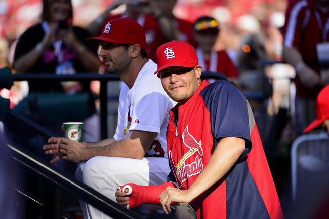 Jul 23, 2014; St. Louis, MO, USA; St. Louis Cardinals catcher Yadier Molina (4) looks on before a game against the Tampa Bay Rays at Busch Stadium. Mandatory Credit: Jeff Curry-USA TODAY Sports