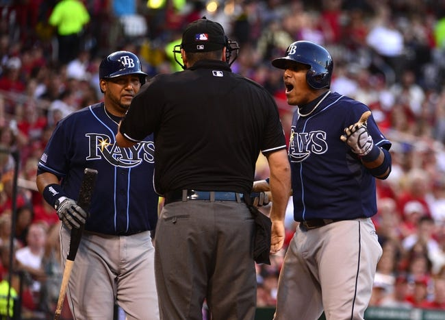 Jul 23, 2014; St. Louis, MO, USA; Tampa Bay Rays shortstop Yunel Escobar (11) is ejected from the game by umpire Dan Bellino (2) for arguing balls and strikes during the fourth inning against the St. Louis Cardinals at Busch Stadium. Mandatory Credit: Jeff Curry-USA TODAY Sports