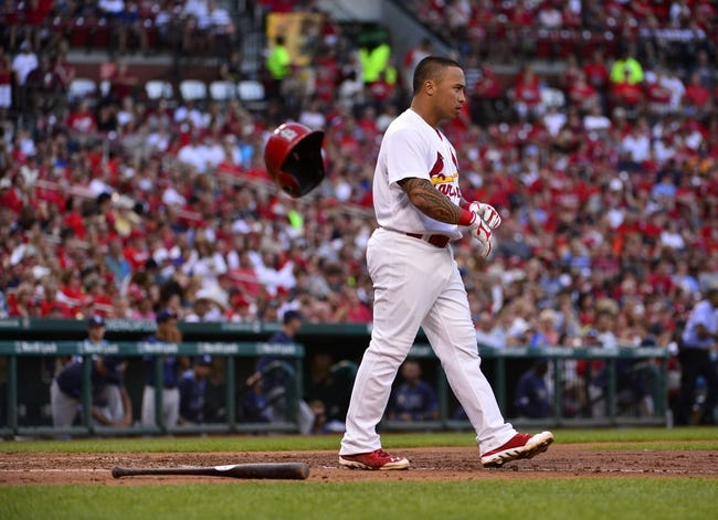 Jul 23, 2014; St. Louis, MO, USA; St. Louis Cardinals second baseman Kolten Wong (16) throws his helmet after striking out during the third inning against the Tampa Bay Rays at Busch Stadium. Mandatory Credit: Jeff Curry-USA TODAY Sports