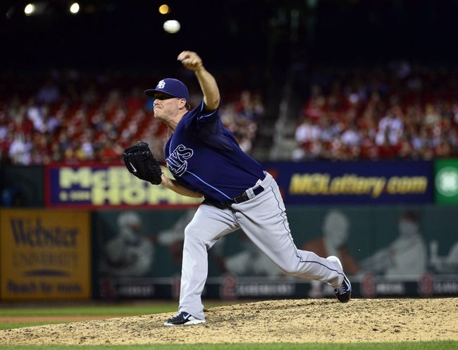 Jul 23, 2014; St. Louis, MO, USA; Tampa Bay Rays relief pitcher Jake McGee (57) throws to a St. Louis Cardinals batter during the ninth inning at Busch Stadium. The Rays defeated the Cardinals 3-0. Mandatory Credit: Jeff Curry-USA TODAY Sports