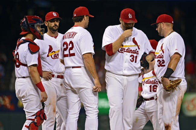 Jul 23, 2014; St. Louis, MO, USA; St. Louis Cardinals starting pitcher Lance Lynn (31) is removed from the game by manager Mike Matheny (22) during the seventh inning against the Tampa Bay Rays at Busch Stadium. The Rays defeated the Cardinals 3-0. Mandatory Credit: Jeff Curry-USA TODAY Sports