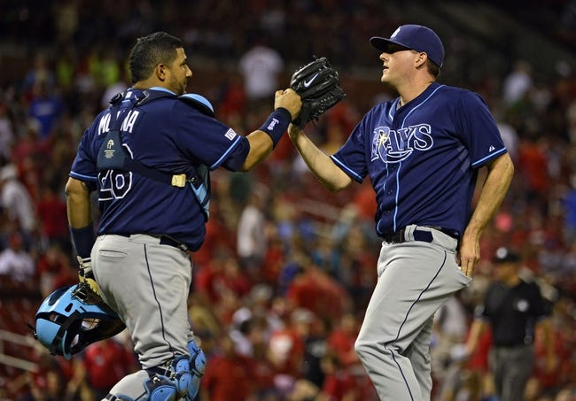Jul 23, 2014; St. Louis, MO, USA; Tampa Bay Rays relief pitcher Jake McGee (57) celebrates with catcher Jose Molina (28) after defeating the St. Louis Cardinals at Busch Stadium. The Rays defeated the Cardinals 3-0. Mandatory Credit: Jeff Curry-USA TODAY Sports