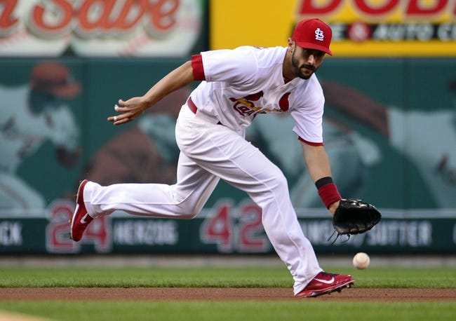 Jul 23, 2014; St. Louis, MO, USA; St. Louis Cardinals third baseman Matt Carpenter (13) fields a ground ball during the second inning against the Tampa Bay Rays at Busch Stadium. The Rays defeated the Cardinals 3-0. Mandatory Credit: Jeff Curry-USA TODAY Sports