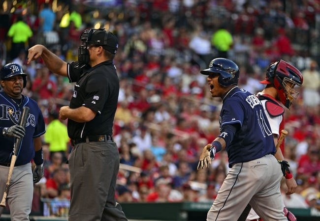 Jul 23, 2014; St. Louis, MO, USA; Tampa Bay Rays shortstop Yunel Escobar (11) reacts after being ejected from the game by umpire Dan Bellino (2) during the fourth inning against the St. Louis Cardinals at Busch Stadium. The Rays defeated the Cardinals 3-0. Mandatory Credit: Jeff Curry-USA TODAY Sports