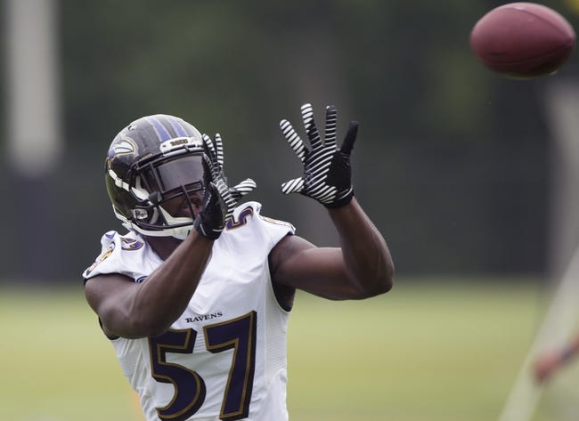 Jul 24, 2014; Owings Mills, MD, USA;  Baltimore Ravens inside linebacker C.J. Mosley (57) prepares to make a catch during practice at Under Armour Performance Center. Mandatory Credit: Tommy Gilligan-USA TODAY Sports