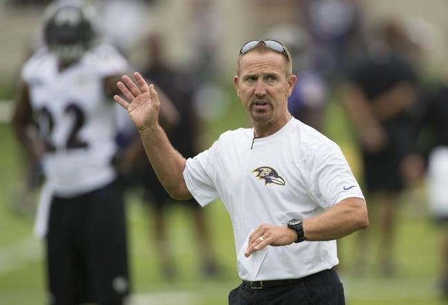 Jul 24, 2014; Owings Mills, MD, USA;  Baltimore Ravens secondary/assistant head coach Steve Spagnuolo speaks with the defensive backs during practice at Under Armour Performance Center. Mandatory Credit: Tommy Gilligan-USA TODAY Sports