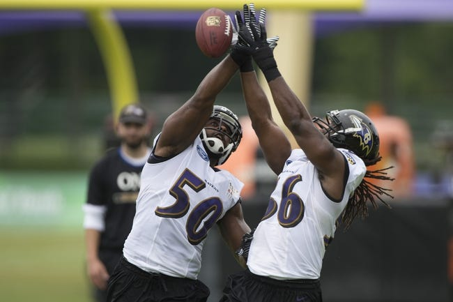 Jul 24, 2014; Owings Mills, MD, USA;  Baltimore Ravens outside linebacker Albert McClellan (50) and  inside linebacker Josh Bynes (56) battle for a ball in the air during practice at Under Armour Performance Center. Mandatory Credit: Tommy Gilligan-USA TODAY Sports