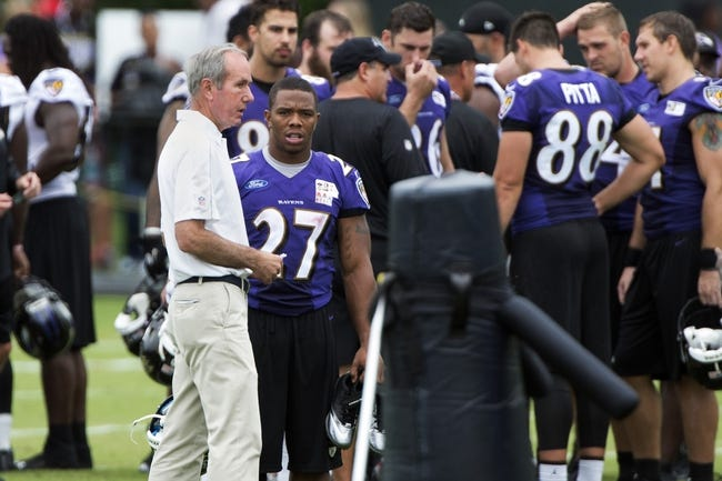 Jul 24, 2014; Owings Mills, MD, USA;  Baltimore Ravens team president  Richard W. Cass  speaks with  running back Ray Rice (27) after practice at Under Armour Performance Center. Mandatory Credit: Tommy Gilligan-USA TODAY Sports