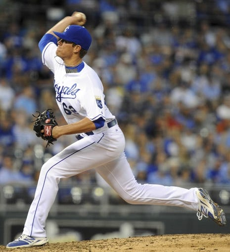 May 3, 2014; Kansas City, MO, USA;  Kansas City Royals relief pitcher Aaron Brooks (62) throws a pitch in the eighth inning against the Detroit Tigers at Kauffman Stadium. Detroit won 9-2. Mandatory Credit: John Rieger-USA TODAY Sports